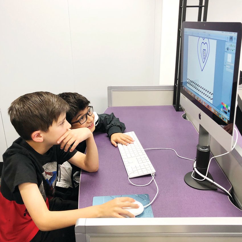 Third-graders Austin Overby, left, and Marcus Chavez design a logo on Pixie, a design software, during a STEM lab visit at Thomson Elementary.