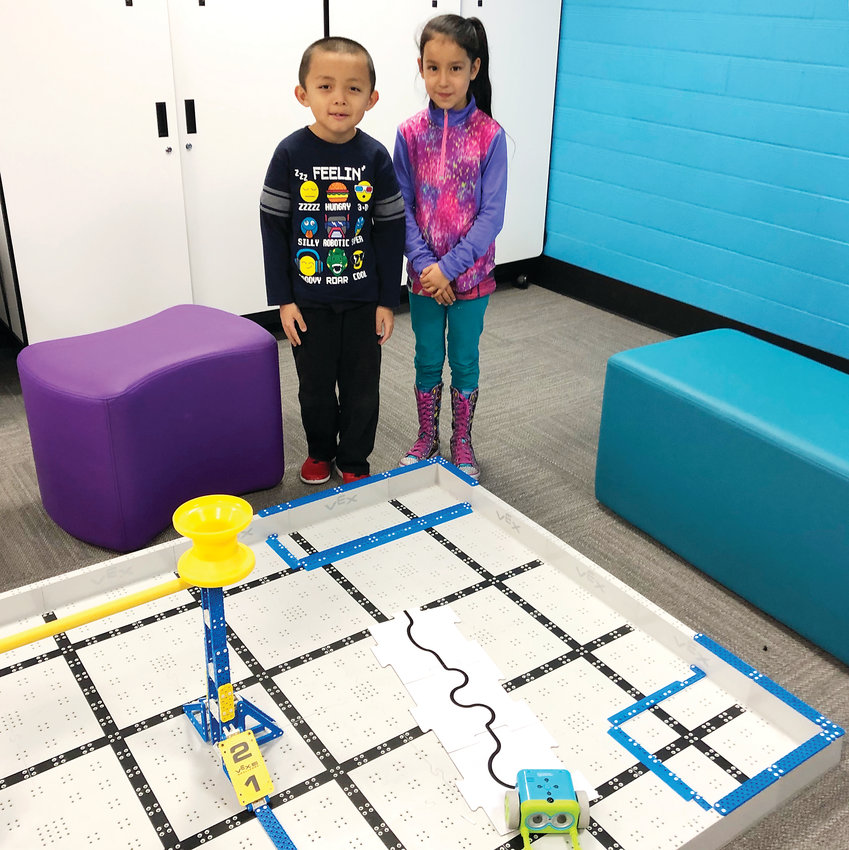 Second-graders Caleb Vo, left, and Dolce Benitez at the robotics station at Swanson Elementary's STEM lab.