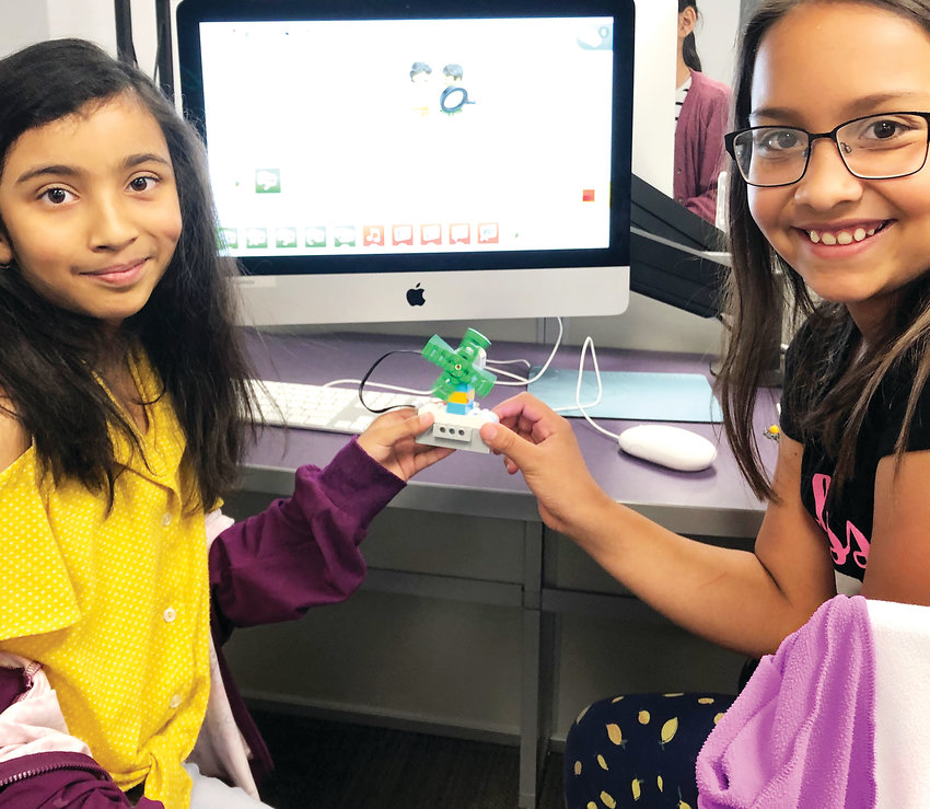 Ruhin Sah, left, and Delenie Olvera, third-graders at Thomson Elementary, use software Lego WeDo 2.0 to create an electronic windmill.