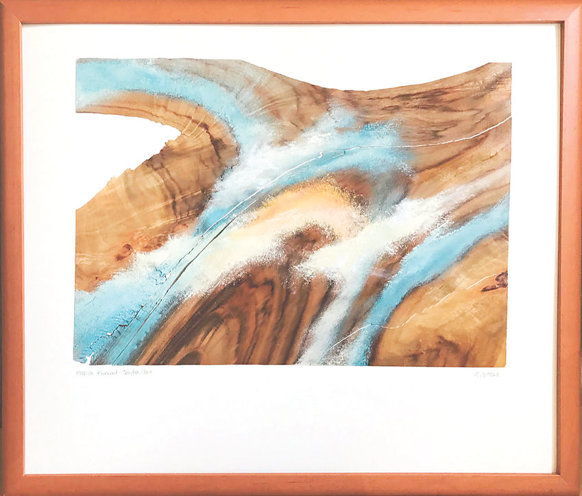 """Sunrise Riverbed"" by Tippy McIntosh won Best of Show in the Depot's annual anniversary show. She paints in oil of pieces of wood veneer floated on a backing and framed."