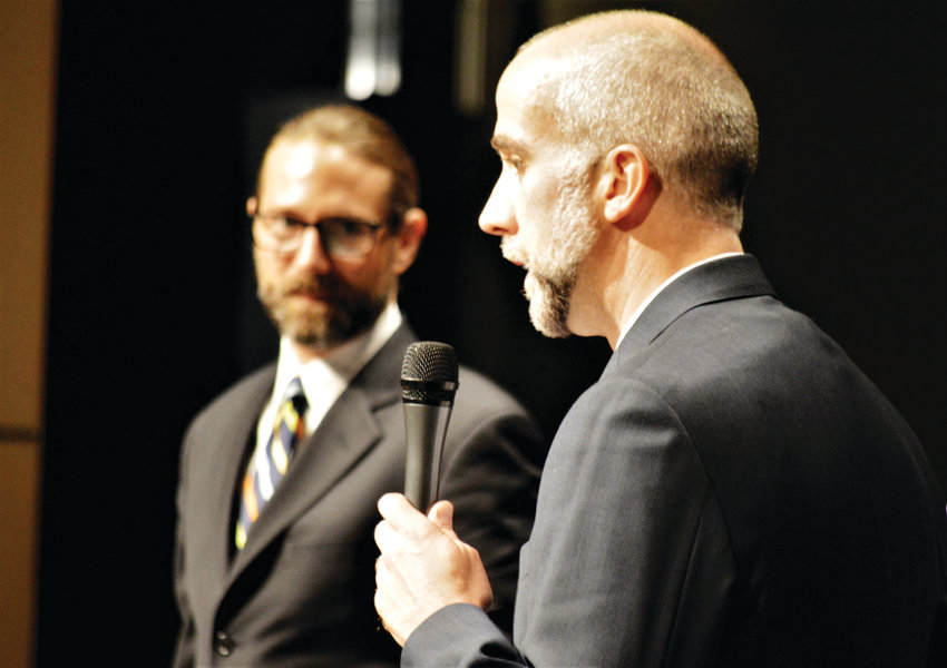 Public Defender James Hardy listens as District Attorney Joseph Michaels discusses his arguments to the State Supreme Court in the Westminster High School Auditorium May 7.