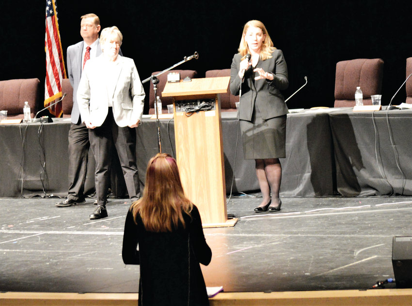 Westminster High School Senior Brianna Coler asks Colorado attorneys Susan Trout, left, and Shelby Deeney about the arguments they presented to the Colorado Supreme Court May 7 in the school's auditorium.