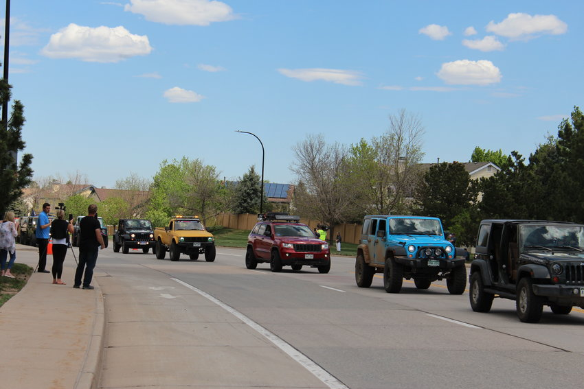 A processional of Jeeps rides through Highlands Ranch May 15 in commemoration of Kendrick Castillo, who had an affinity for cars, specifically his green Jeep Cherokee.