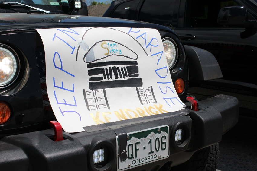 "A poster on the grill of a Jeep reads ""Jeep In Paradise Kendrick,"" commemorating Kendrick Castillo, who was killed during the May 7 STEM School Highlands Ranch shooting."