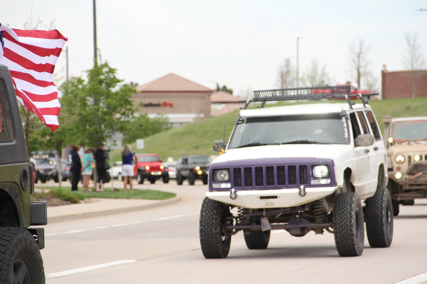 A line of Jeeps and some other vehicles went by for nearly 20 minutes near Cherry Hills Community Church for a May 15 memorial service for Kendrick Castillo in Highlands Ranch.