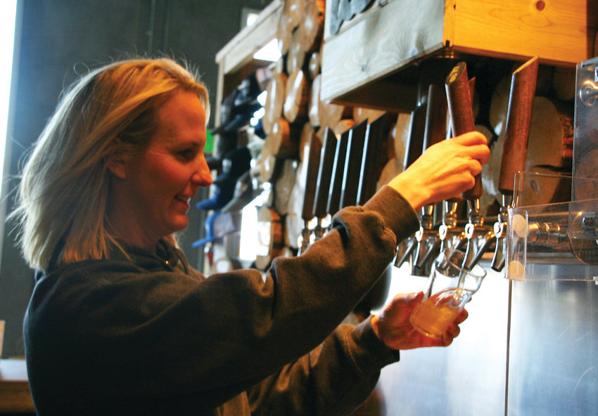 Karen Hertz, owner and founder of Holidaily Brewing Company, pours a Favorite Blonde Ale from inside the brewery's taproom, 801 Brickyard Circle in Golden. Now that Holidaily has expanded its production facility to a new building across the street, it will be the largest gluten free brewery, by volume, in the U.S.