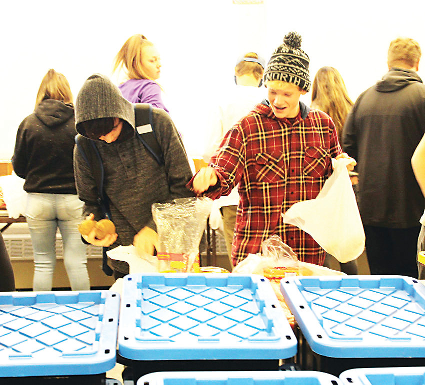 Volunteers pack food for Jeffco Eats. The organization feeds around 400 children a week in Jefferson County.