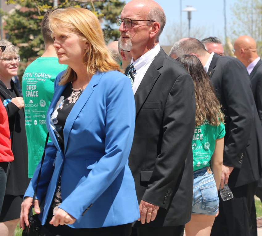 DCSD School Board President David Ray and board member Krista Holtzmann walk into a celebration for life for Kendrick Castillo on May 15 at Cherry Hills Community Church. Castillo was killed in a May 7 school shooting at STEM School Highlands Ranch.