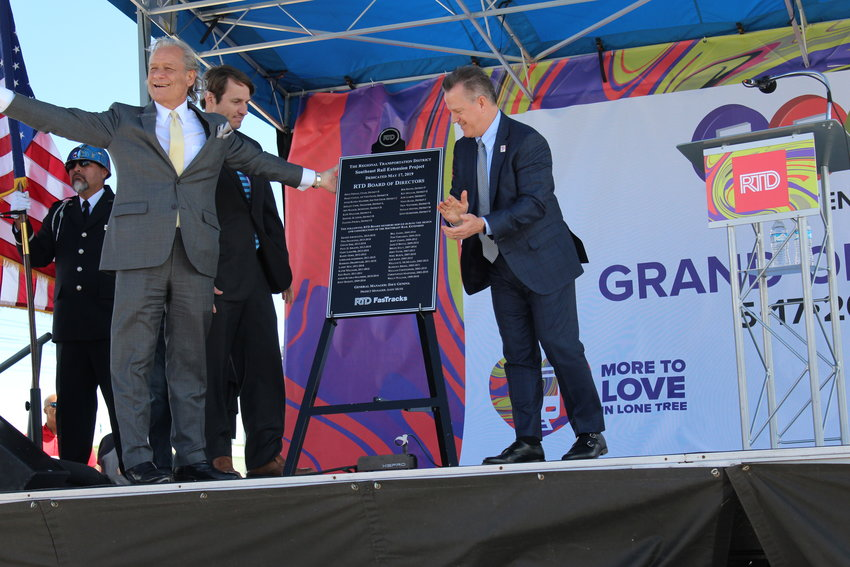 RTD board chair Doug Tisdale, RTD CEO Dave Genova and RTD board member Ken Mihalik reveal a plaque dedicated to the collaborators of the Southeast Rail Extension project, which opened officially May 17.