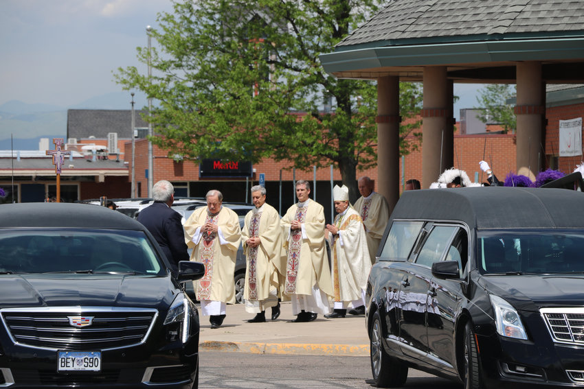 Bishops at St. Mary Catholic Parish in Littleton lead the Castillos out of the church following the May 17 funeral of their son, Kendrick Castillo.