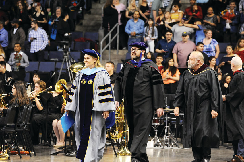 Westminster Public Schools Superintendent Pam Swanson and Board of Education member Larry Dino Valente, lead the processional for Westminster High School's graduation, held Saturday, May 18, at the First Bank Center in Broomfield.