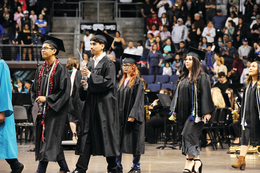A group of Westminster High School graduates enters the floor of the First Bank Center during graduation ceremonies May 18 in Broomfield.