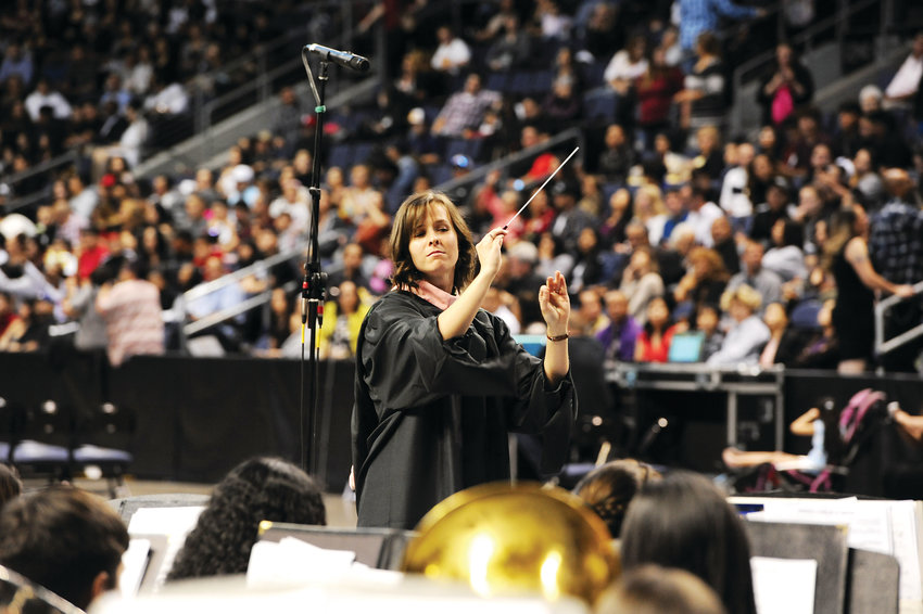 Westminster High School music teacher Megan Lewin conducts the school's concert band during graduation ceremonies May 18, at the First Bank Center in Broomfield.