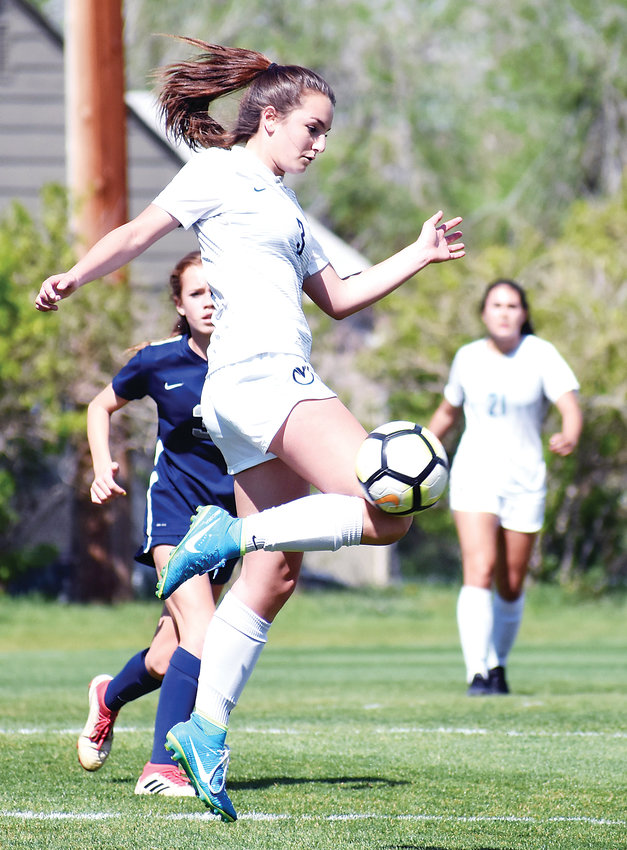 Ralston Valley freshman Madison Schwartz (3) attempts to settle a ball to her feet during a state quarterfinal game against Columbine on May 15 at Lakewood Memorial Field.