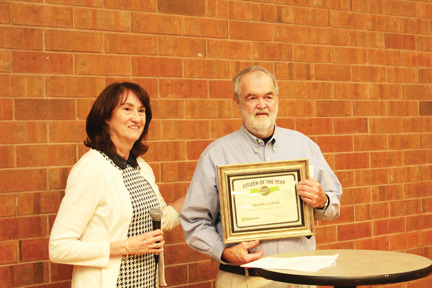 Englewood Mayor Linda Olson and Bill Clayton pose during a celebration that honored him as Citizen of the Year.