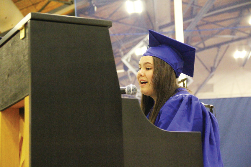 "Student Chelsea Langley sings and plays ""Goodbye Stranger"" by Supertramp at the piano May 18 during Englewood High's graduation."