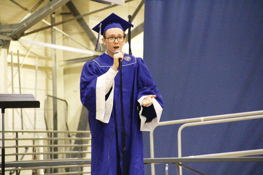 "Englewood High School student Albert Lee sings Frank Sinatra's ""My Way"" during EHS' graduation May 18. Lee was one of three students who performed music solo, and the school's choir also performed."
