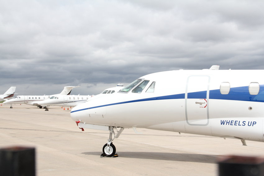 Planes stand at Centennial Airport on May 7. That airport is among those that may have flight paths re-routed by the Denver Metroplex plan by the Federal Aviation Administration.