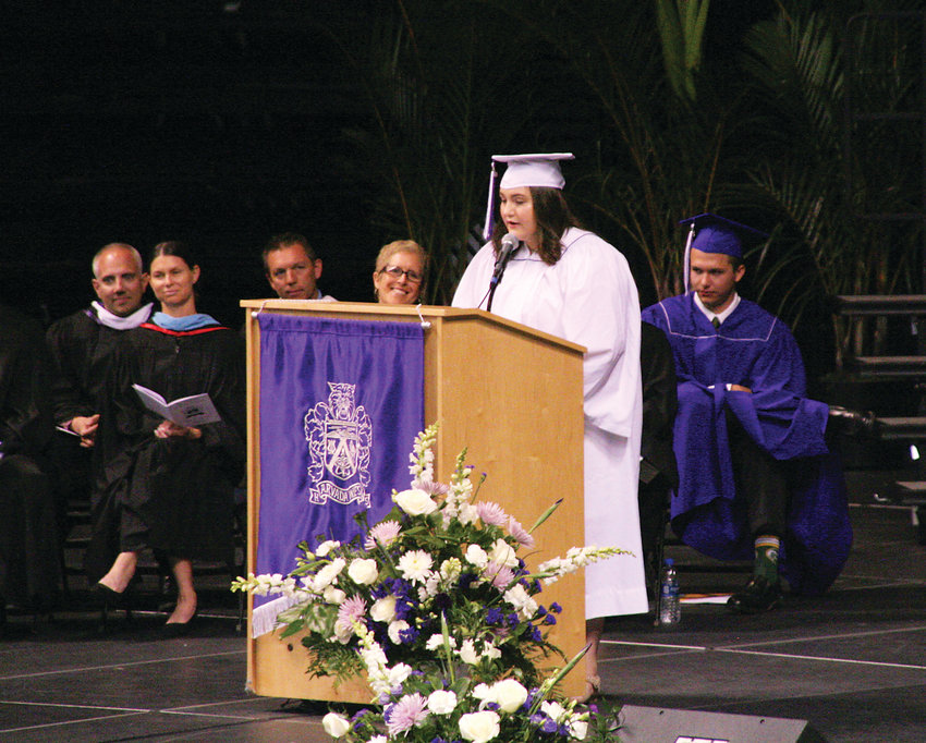 "Brooke Miller, the second student speaker at Arvada West High School's Class of 2019 commencement ceremony addresses her fellow graduates on May 17. ""We can change the world,"" she said. ""And we need to try to do it."""