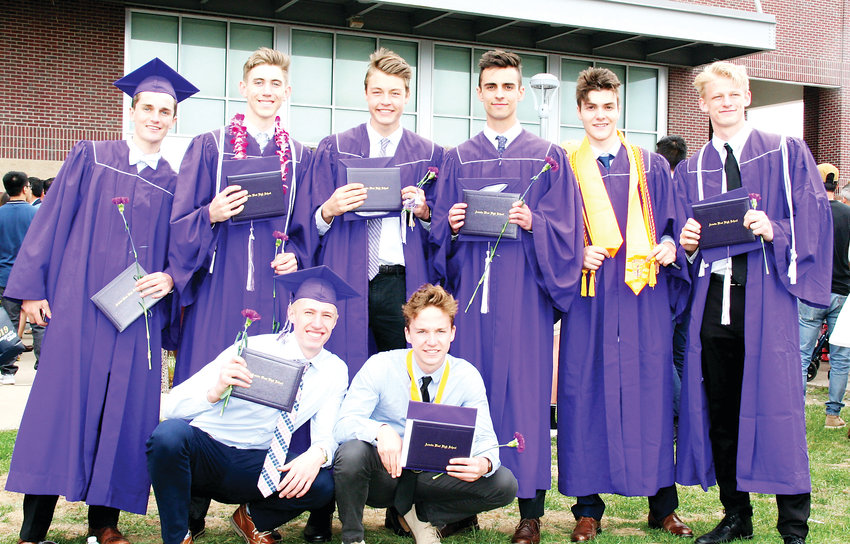 A group of Arvada West High School's basketball players and friends gather for a photo outside of the 1st Bank Center following the school's 2019 graduation on May 17.