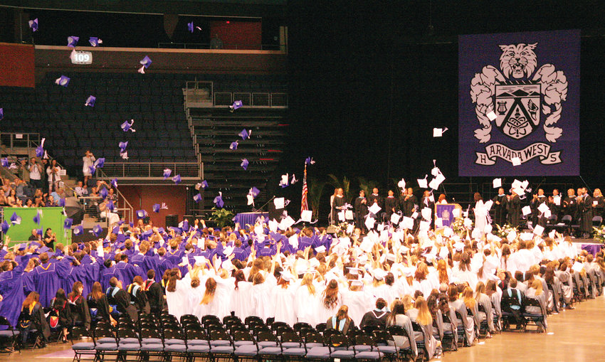 Arvada West High School's Class of 2019 toss their caps in the air to celebrate its commencement on May 17 inside the 1st Bank Center in Broomfield.
