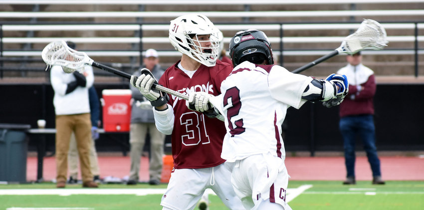 Golden junior Dylan Mathias (31) tries to get off a shot as Cheyenne Mountain sophomore Zak Paige closes in during the first quarter Monday, May 20, at All-City Stadium. Mathias is one of a host of key returning players for the now defending Class 4A boys lacrosse state champions