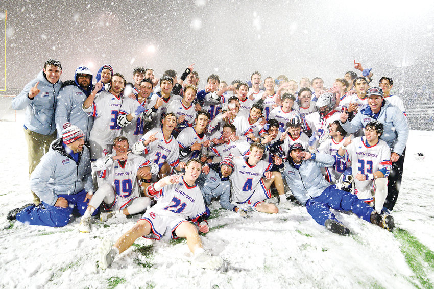 Cherry Creek's boys lacrosse team gets in a last chance to play in the snow as they celebrate their 12-7 victory over Kent Denver in the 5A State Final on May 20 at All City Field.