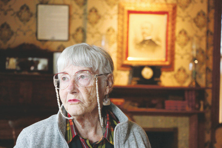 Winnie Burdan, a volunteer with the Friends of Historic Fort Logan, stands in the parlor of the old Field Officer's Quarters, which today houses the fort museum.