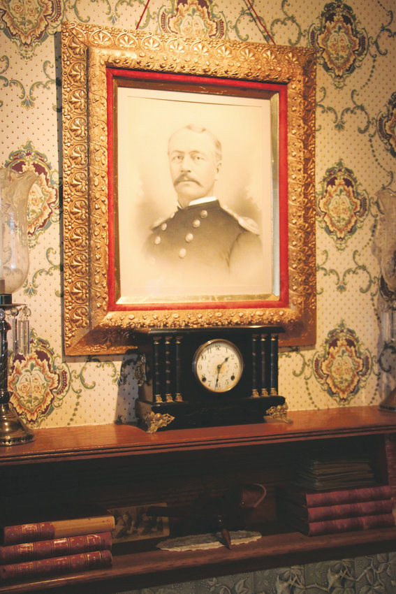 A portrait of Col. Henry Merriam, Fort Logan's longest-serving commander, hangs over the fireplace in the fort museum.