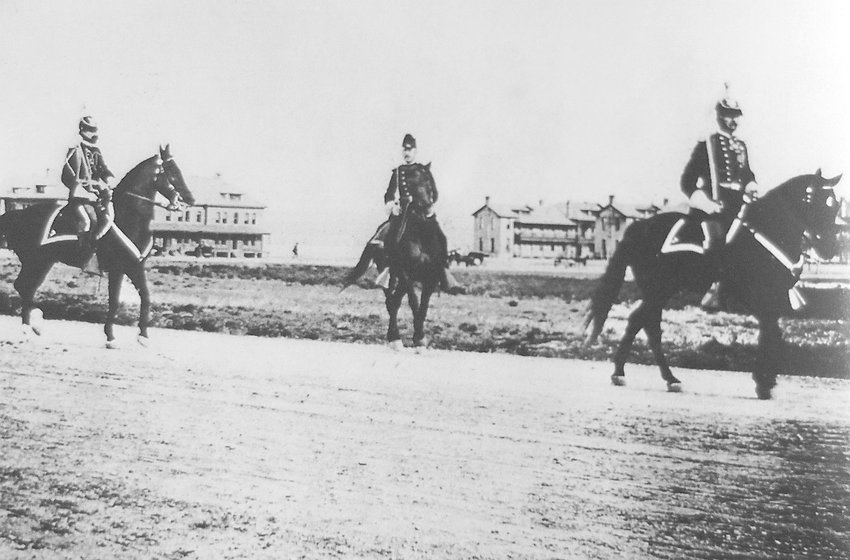 Col. Merriam, right, and two other officers on Fort Logan's parade ground toward the end of the 19th century.
