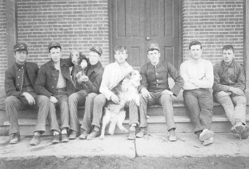 Troops sit on the porch of a barracks building in the early years of the 20th century. Courtesy of Friends of Historic Fort Logan