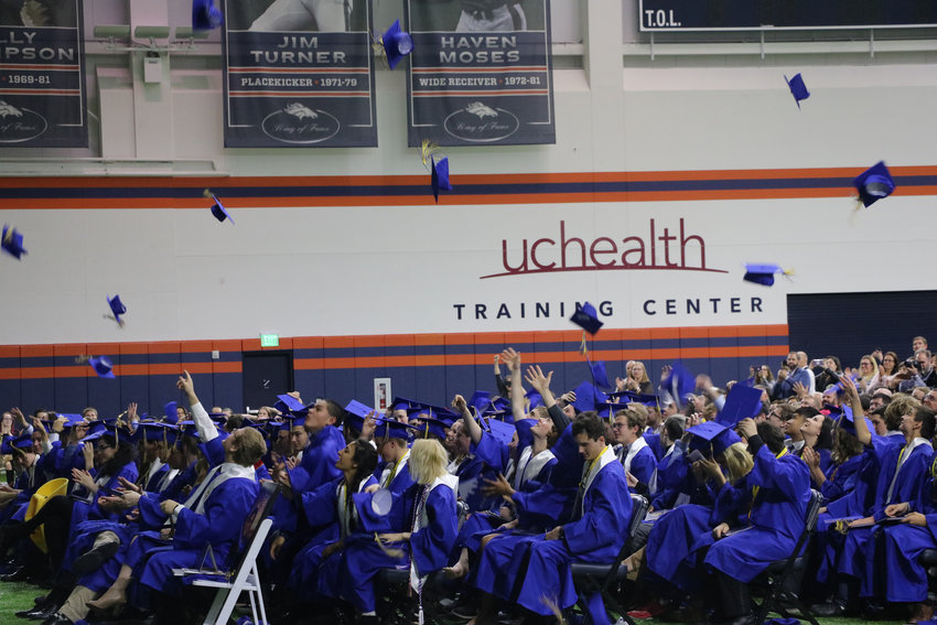 Graduates of STEM School Highlands Ranch close one chapter at a May 20 commencement ceremony at the Broncos Training Facility.