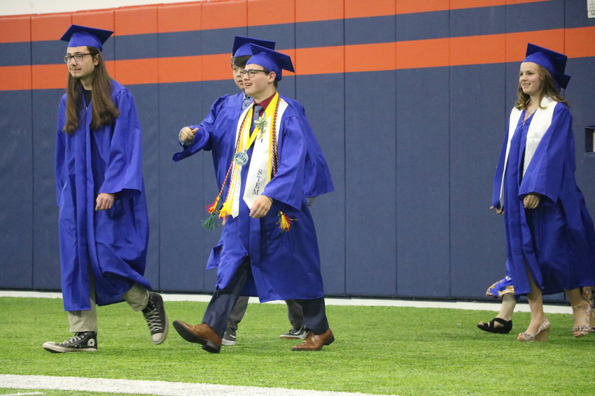 STEM School Highlands Ranch graduates stride into the Broncos Training Facility on May 20 for the 2019 commencement ceremony.
