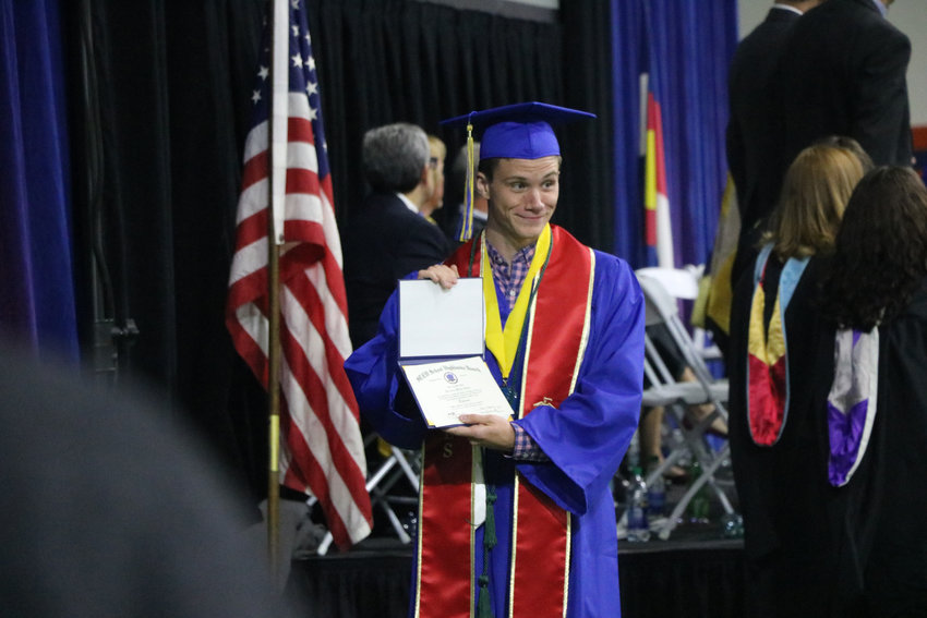 Brendan Bialy, one of three STEM Highlands Ranch students who helped take down a gunman on May 7, receives his diploma at a May 20 commencement ceremony. Bialy plans to join the Marines.