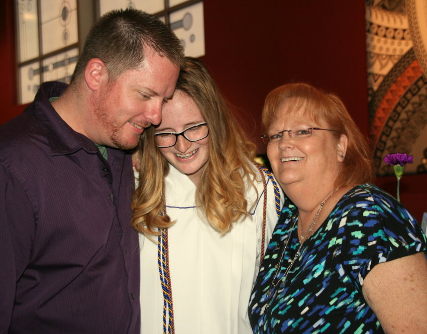Arvada West High School Class of 2019 graduate Katelynn Czyzewski gets congratulated by her father Jeremy and grandmother Belinda Starr following the commencement ceremony on May 17.