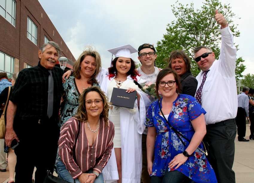 Amanda DeJarnette's family celebrates their graduate after Arvada West High School's Class of 2019 commencement ceremony on May 17.