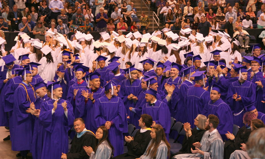 Arvada West High School's Class of 2019 graduates look around and applaud the friends and family attending the school's graduation ceremony to thank them for their support on May 17.