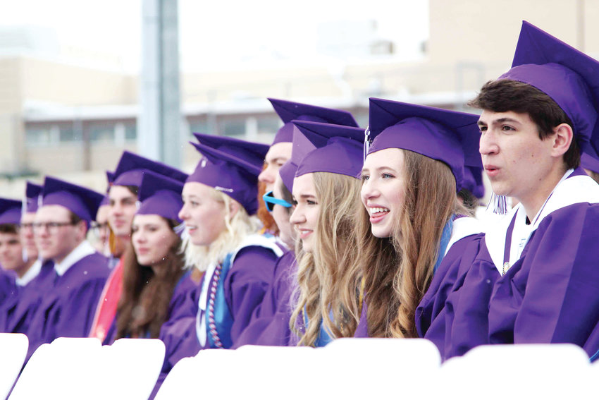Seniors watch as friends line up to receive their diploma May 21 at the Douglas County High School graduation ceremony in Castle Rock.