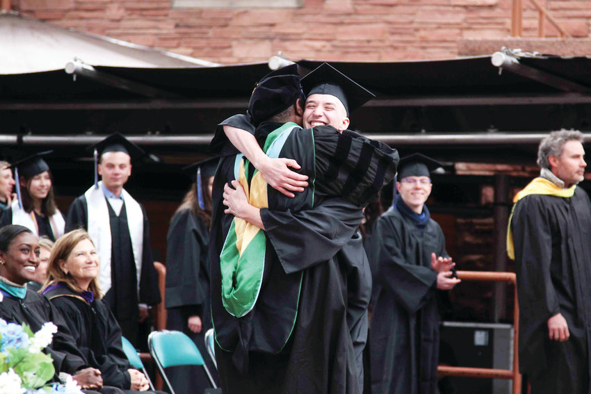 Students got a handshake and big hug from Principal Christopher Page during the 2019 graduation ceremony for Highlands Ranch High School on May 22.