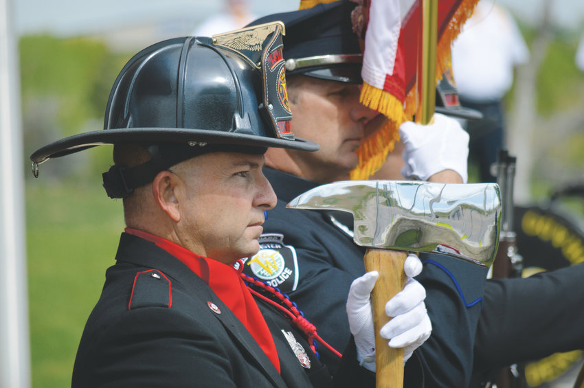 A Westminster firefighter, a member of the City of Westminster's Fire and Police Honor Guard, stands at attention during the city's annual Armed Forces Day commemoration at the Westminster Armed Forces Tribute Garden.