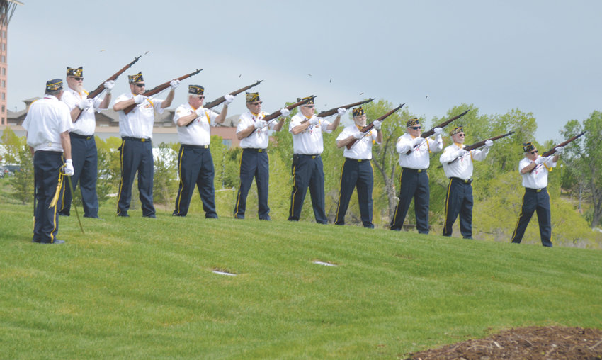 Members of the American Legion Post 11-11 and 22 fire off a 21- gun salute May 18 along Westminster Boulevard to mark Armed Forces Day.