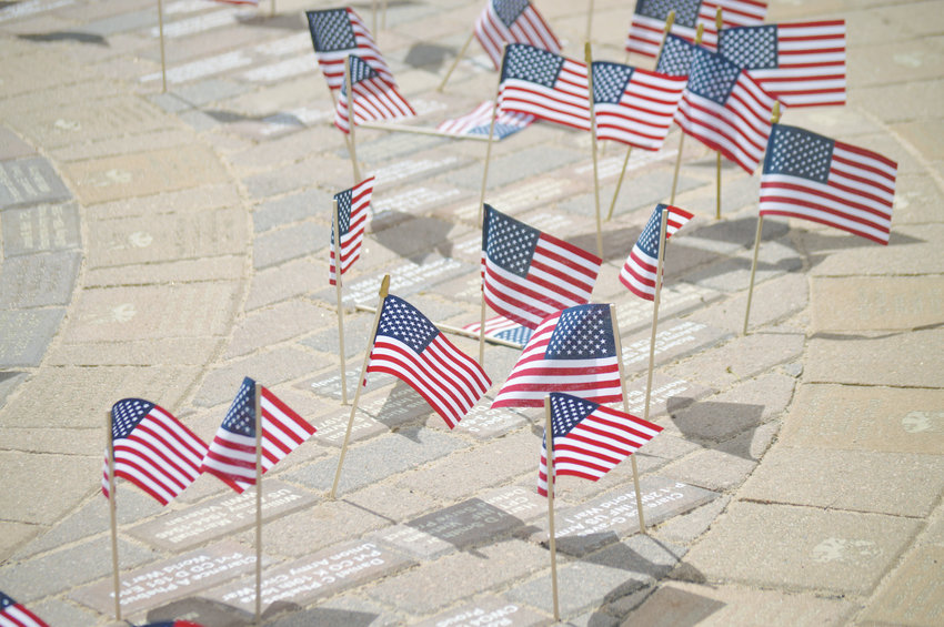 People marked the bricks honoring their loved ones with small U.S. flags at Westminster Armed Forces Tribute Garden May 18, Armed Forces Day 2019.