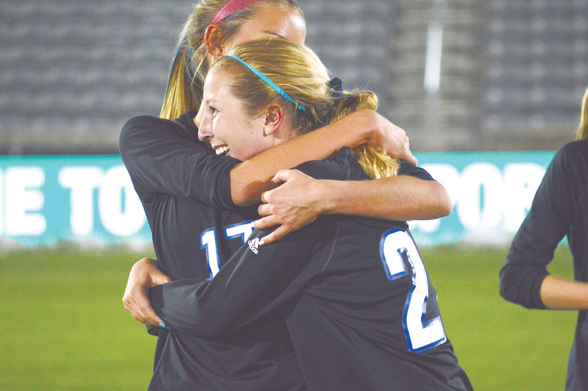 Lauren Holleran (17) hugs (22) Skyler Whitcher as Grandview's girls soccer team defeated Arapahoe 2-1 on May 22 at Dick's Sporting Goods Park to win the Class 5A state championship.