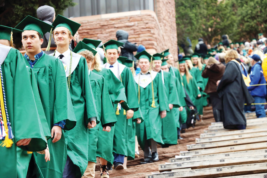 Mountain Vista graduates walk to their seats as the 2019 commencement ceremony kicks off. The May 22 graduation was held at at Red Rocks Amphitheatre.