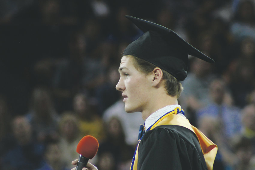 Luke Dreyfuss delivers a class address on perseverance May 25 at the 2019 Rock Canyon graduation ceremony at Magness Arena.