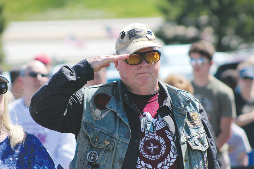 A veteran salutes during the playing of the national anthem at the Memorial Day ceremony at the Parker Cemetery May 28.