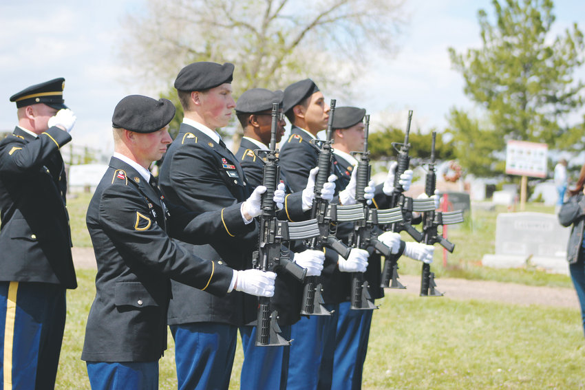 The Fort Carson Fourth Engineer Battalion Honor Guard performs a 21-gun salute during the Memorial Day ceremony at the Parker Cemetery May 27.