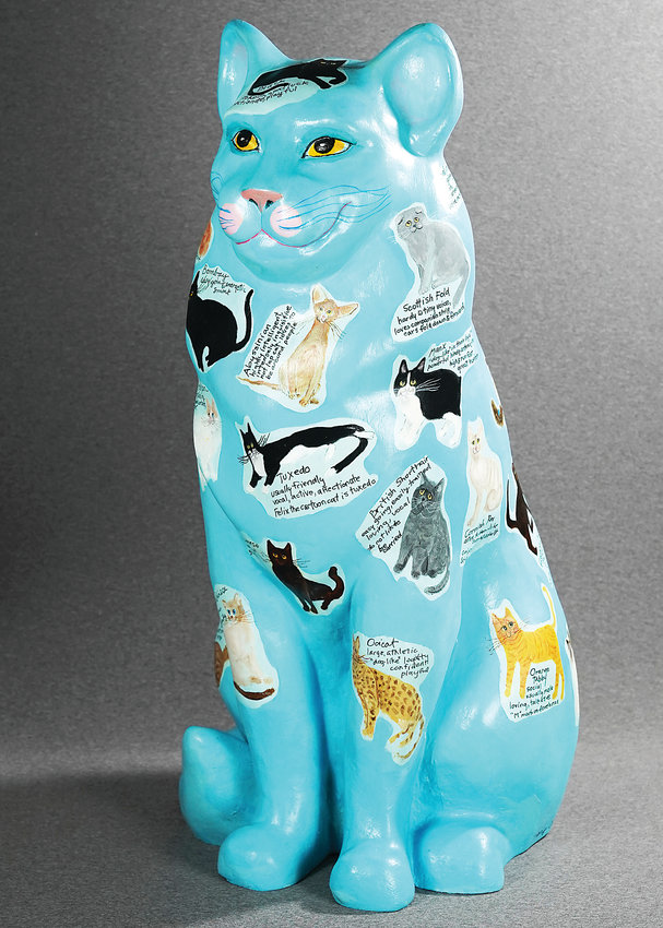 Cat sculpture, painted by Mary Clark of the Littleton Fine Arts Guild. A collection of Painted Cats will be exhibited at the Depot Art Center June 3 to 23.