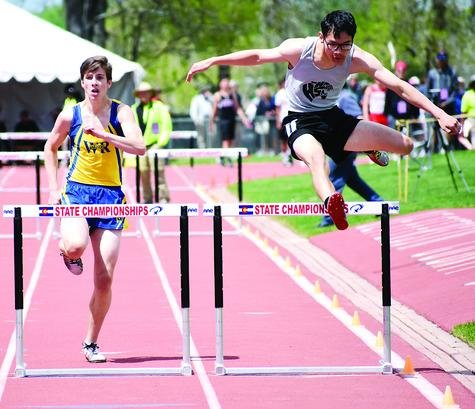 Wheat Ridge sophomore Sam McDonough, left, prepares to clear the final hurdle during the Class 4A boys 300-meter hurdle final at the state track and field championships Saturday, May 18, at Jeffco Stadium. McDonough placed eighth with a time of 41.68 seconds.