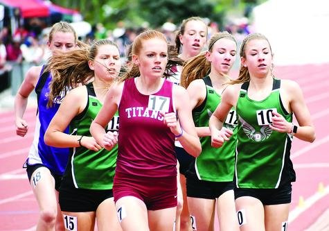 D'Evelyn's trio of distance runners — Taylor Haerbig (10), Katelyn Haerbig (12) and Sonja Morin (15) — run with a pack during the Class 3A girls 1,600 final during Day 3 of the state track and field championships Saturday, May 18, at Jeffco Stadium. The D'Evelyn girls racked up 37 team points during the state meet to place ninth. D'Evelyn senior Esther Diza-Mbelolo had a strong meet placing second in the 100 hurdles, fourth in the 300 hurdles and fifth in the 100 dash final.